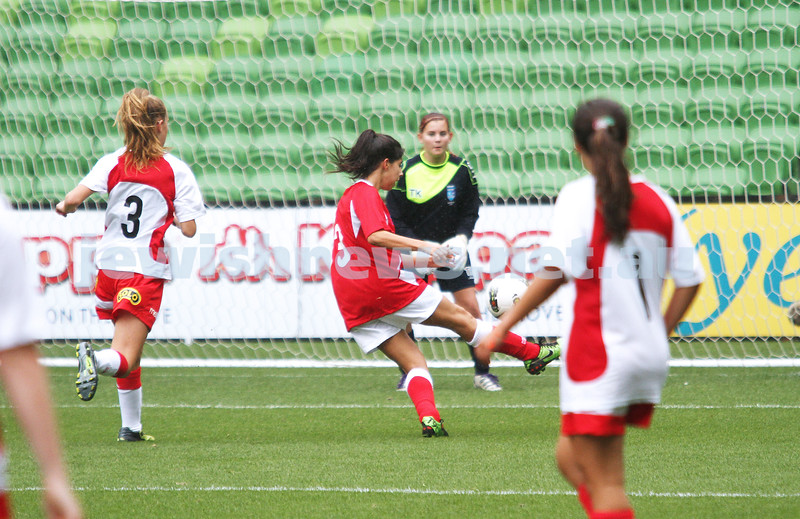 16-3-13. Girls with Heart soccer match. AAMI Park, Melbourne. Rebecca Rubinstein takes a shot on goal .Photo: Peter Haskin