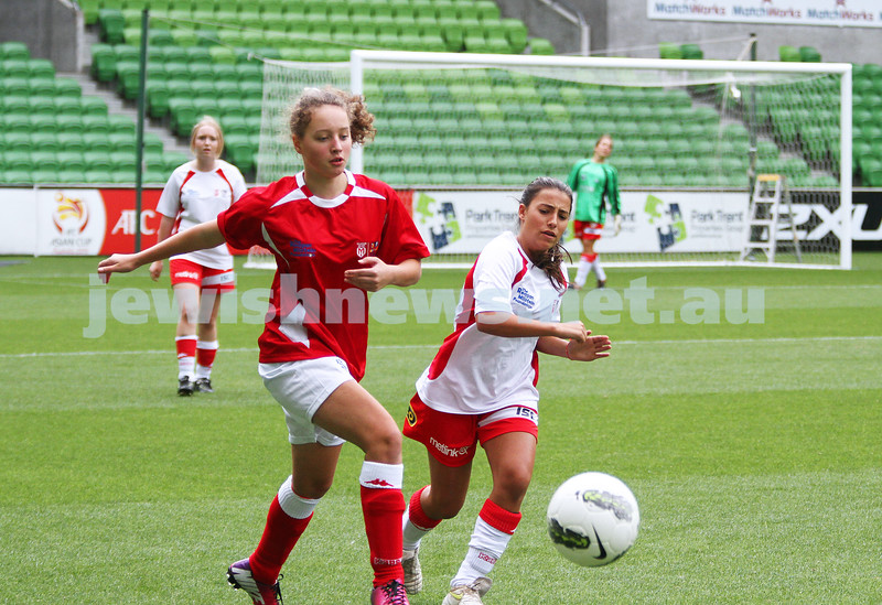 16-3-13. Girls with Heart soccer match. AAMI Park, Melbourne. xxxxxxx (left) playing the ball. Photo: Peter Haskin