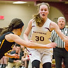 Record-Eagle/Brett A. Sommers Charlevoix's Elise Stuck attacks a Glen Lake defender during Thursday's regional championship game. Glen Lake won 56-44.