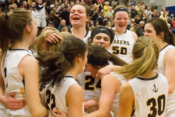 Record-Eagle/Brett A. Sommers <br /> <br /> Glen Lake's players celebrate after winning Tuesday's Class C quarterfinal girls basketball game in Gaylord against St. Ignace. Glen Lake won 63-52.
