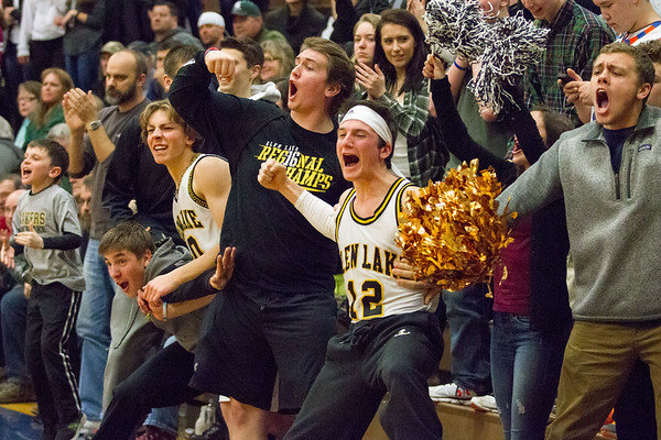 Record-Eagle/Brett A. Sommers <br /> <br /> Glen Lake's student section erupts after a made Lakers' basket during Tuesday's Class C quarterfinal girls basketball game in Gaylord against St. Ignace. Glen Lake won 63-52.