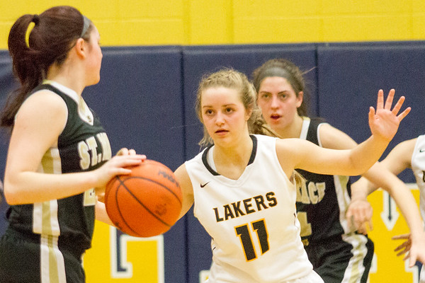 Record-Eagle/Brett A. Sommers <br /> <br /> Glen Lake's Allie Bonzelet plays defense during Tuesday's Class C quarterfinal girls basketball game in Gaylord against St. Ignace. Glen Lake won 63-52.