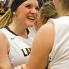 Record-Eagle/Brett A. Sommers <br /> <br /> Glen Lake's Kasidy Skipski embraces a teammate following Tuesday's Class C quarterfinal girls basketball game in Gaylord against St. Ignace. Glen Lake won 63-52.