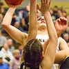 Record-Eagle/Brett A. Sommers <br /> <br /> Glen Lake's Savannah Peplinski attempts a shot over the defense during Tuesday's Class C quarterfinal girls basketball game in Gaylord against St. Ignace. Glen Lake won 63-52.