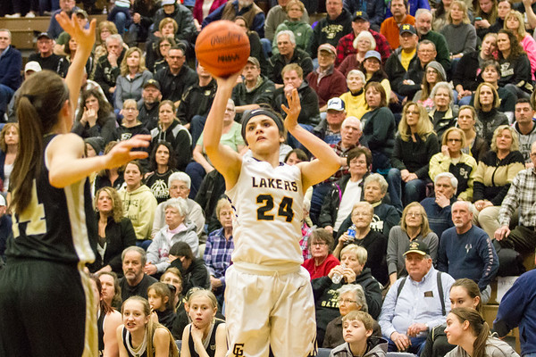Record-Eagle/Brett A. Sommers <br /> <br /> Glen Lake's Savannah Peplinski fires a three-pointer during Tuesday's Class C quarterfinal girls basketball game in Gaylord against St. Ignace. Glen Lake won 63-52.