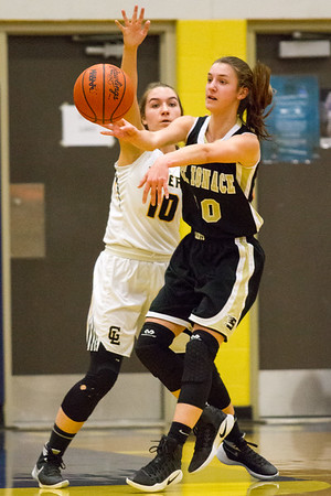 Record-Eagle/Brett A. Sommers <br /> <br /> Glen Lake's Jennifer LaCross guards St. Ignace's Emily Coveyou during Tuesday's Class C quarterfinal girls basketball game in Gaylord against St. Ignace. Glen Lake won 63-52.