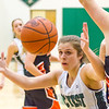 Record-Eagle/Brett A. Sommers Traverse City West's Becca Bohrer attempts to secure a loose ball during Monday's girls basketball game against Ludington at TC West High School. TC West won 44-38.