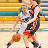 Record-Eagle/Brett A. Sommers Traverse City West's Sierra Perkette fights to the basket against Ludington's Abby Millspaugh during Monday's girls basketball game at TC West High School. TC West won 44-38.
