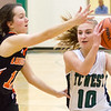 Record-Eagle/Brett A. Sommers Traverse City West's Bree Welch (10) is guarded by Ludington's Mackenzie Luce (12) during Monday's girls basketball game at TC West High School. TC West won 44-38.