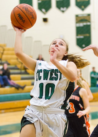 Record-Eagle/Brett A. Sommers Traverse City West's Bree Welch shoots a layup during Monday's girls basketball game against Ludington at TC West High School. TC West won 44-38.