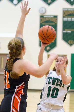 Record-Eagle/Brett A. Sommers Traverse City West's Bree Welch shoots a jump shot over Ludington's Mackenzie Howe (41) during Monday's girls basketball game at TC West High School. TC West won 44-38.