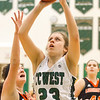 Record-Eagle/Brett A. Sommers Traverse City West's Becca Bohrer shoots the ball during Monday's girls basketball game against Ludington at TC West High School. TC West won 44-38.