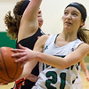 Record-Eagle/Brett A. Sommers Traverse City West's KK Roman is fouled in the act of shooting during Monday's girls basketball game against Ludington at TC West High School. TC West won 44-38.