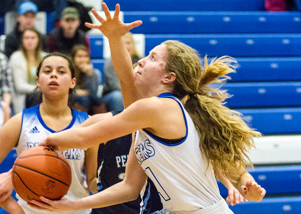 Record-Eagle/Brett A. Sommers Kalkaska's Margaret Stosio attempts a layup during Monday's game against Petoskey. Kalkaska won 52-34.