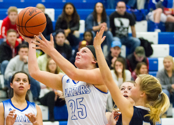 Record-Eagle/Brett A. Sommers Kalkaska's Makenzie Wilkinson attempts a layup during Monday's game against Petoskey. Kalkaska won 52-34.