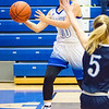 Record-Eagle/Brett A. Sommers Kalkaska's Kayla Cavanaugh jumps and fires a pass along the baseline during Monday's game against Petoskey. Kalkaska won 52-34.
