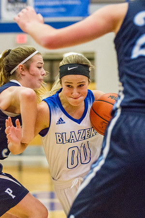 Record-Eagle/Brett A. Sommers Kalkaska's Kayla Cavanaugh drives the ball to the basket during Monday's game against Petoskey. Kalkaska won 52-34.