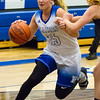 Record-Eagle/Brett A. Sommers Kalkaska's Makenzie Wilkinson dribbles the ball aginst a Petoskey defender during Monday's game. Kalkaska won 52-34.