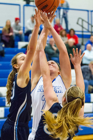 Record-Eagle/Brett A. Sommers Kalkaska's Ruby Clyburn attempts to corrall a rebound against a pair of Petoskey opponents during Monday's game. Kalkaska won 52-34.