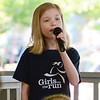 Will Fehlinger | The Herald-Tribune<br /> Anna Wanstrath sings the National Anthem to kick off the 2017 Girls on the Run 5K event at Liberty Park May 13.