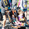 Will Fehlinger | The Herald-Tribune<br /> A pair of toddlers take a free ride along the Girls on the Run 5K route on May 13 at Liberty Park.