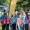 Will Fehlinger | The Herald-Tribune<br /> Runners and walkers gather at the starting line on Park Avenue before the May 13 Girls on the Run non-competitive 5K.
