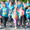 Will Fehlinger | The Herald-Tribune<br /> Participants are all smiles as the spring Girls on the Run 5K gets underway next to Liberty Park on Saturday morning, May 13.