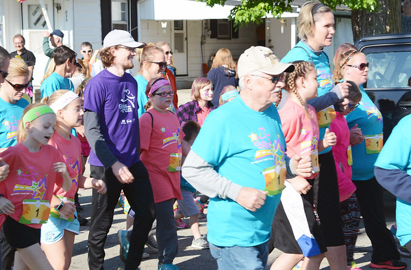 Will Fehlinger | The Herald-Tribune<br /> Young and old alike were enthusiastic about the spring Girls on the Run 5K race, held May 13 at Liberty Park.