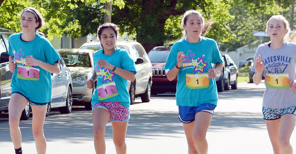 Will Fehlinger | The Herald-Tribune<br /> A quartet of girls are among the first to finish the spring Girls on the Run 5K on Saturday morning, May 13. The run began on Park Avenue and concluded in Liberty Park.