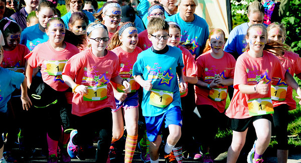 Will Fehlinger | The Herald-Tribune<br /> Runners take off at the start of Saturday's spring Girls on the Run 5K at Liberty Park. Nearly 250 girls (among 600-plus participants) from Ripley, Decatur and Franklin counties completed a 10-week season of the GOTR program by racing alongside running/walking buddies. The GOTR girls wore coral-colored shirts, running buddies and others wore blue shirts and coaches wore violet-colored shirts.