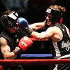 Night 2 of 2017l Golden Gloves. Jared Laganas of Hudson, NH, originally of Dracut, from SLS Boxing (Red), left, won by unanimous decision over Furcy Ferrera of Peabody and Private Jewels (Blue), in 165  lb Novice bout. (SUN/Julia Malakie)