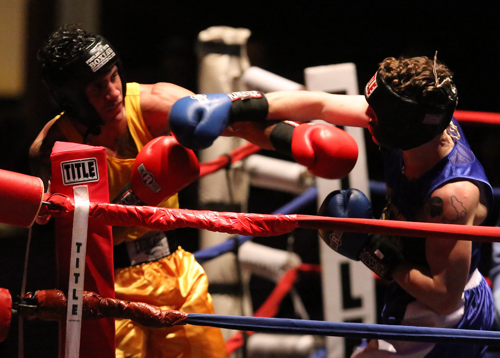 . New England Golden Gloves, Open Division. Josniel Castro of Portland, ME (NNE, Red corner), left, was winner by unanimous decision over Luca Botis of West Point, NY (WNE, Blue corner) in 152 lb Open semifinal. (SUN/Julia Malakie)