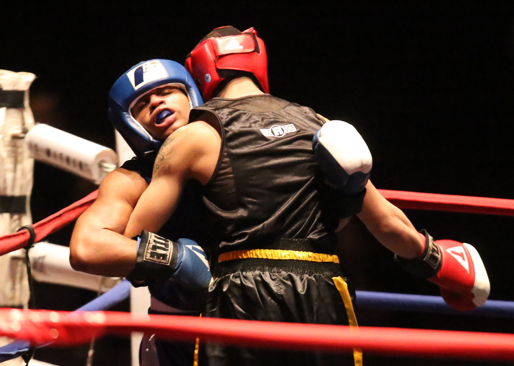 . New England Golden Gloves, Open Division.Jonathan DePina of Dorchester (Red corner), right, was winner by a 3-2 decision over Joshua Orta of Springfield (Blue corner), left, in 132 lb Open semifinal. (SUN/Julia Malakie)
