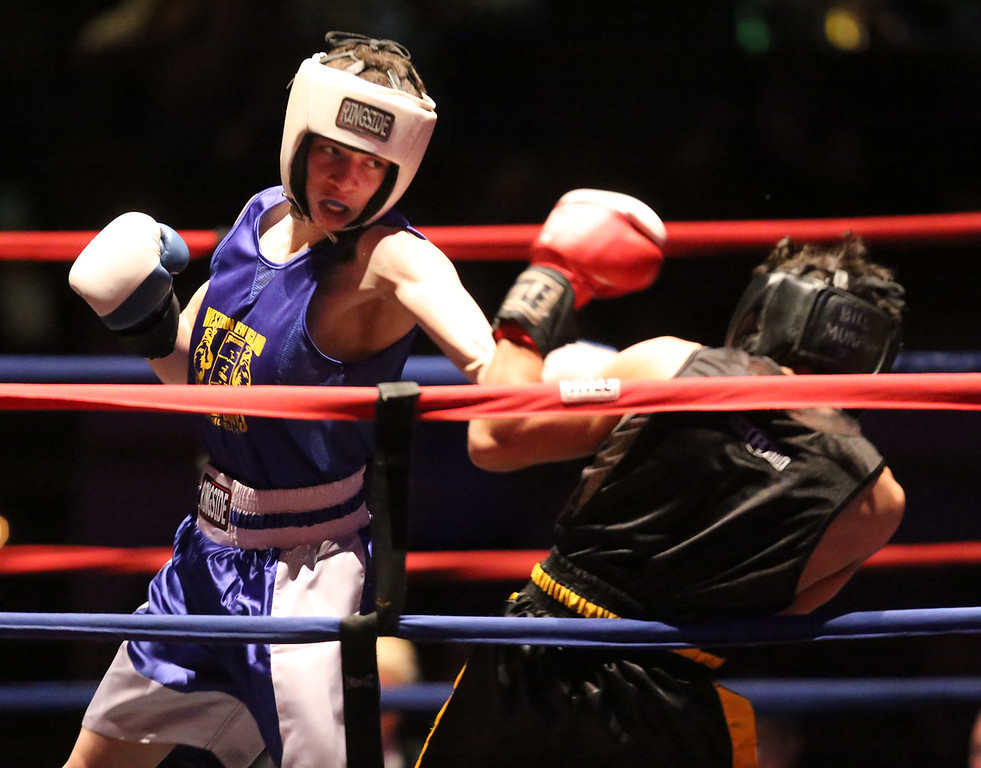 . New England Golden Gloves, Open Division. Felix Parilla of North Haven, CT (Blue corner), left, was winner by decision over Joseph Valdes of Nashua in 123 lb Open semifinal. (SUN/Julia Malakie)