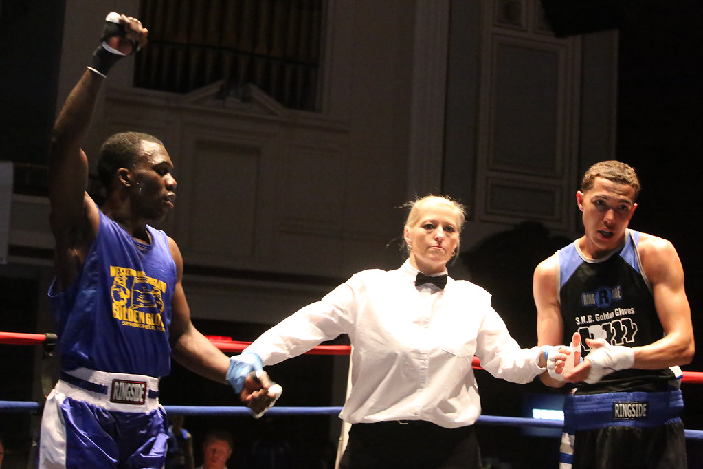 . New England Golden Gloves, Open Division. Sharad Collier of Hartford (Blue corner), left, is winner by unanimous decision over Miles Bloodworth of Woonsocket in 141 lb Open semifinal. Referee is Lucy Miller. (SUN/Julia Malakie)