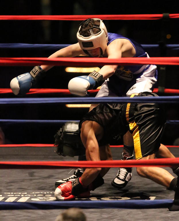 . New England Golden Gloves, Open Division. Felix Parilla of North Haven, CT (Blue corner), rear, was winner by decision over Joseph Valdes of Nashua, front, in 123 lb Open semifinal. (SUN/Julia Malakie)