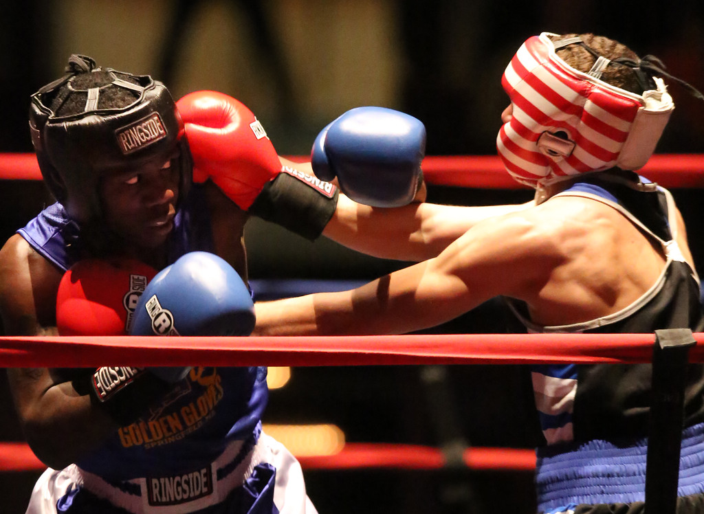 . New England Golden Gloves, Open Division. Sharad Collier of Hartford (Blue corner), left, was winner by unanimous decision over Miles Bloodworth of Woonsocket in 141 lb Open semifinal. Referee is Lucy Miller. (SUN/Julia Malakie)