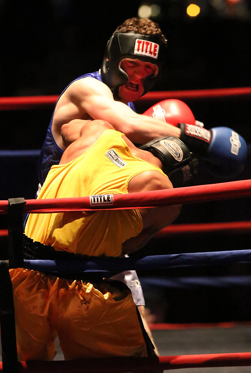 . New England Golden Gloves, Open Division. Josniel Castro of Portland, ME (NNE, Red corner), front, was winner by unanimous decision over Luca Botis of West Point, NY (WNE, Blue corner), rear, in 152 lb Open semifinal.  (SUN/Julia Malakie)