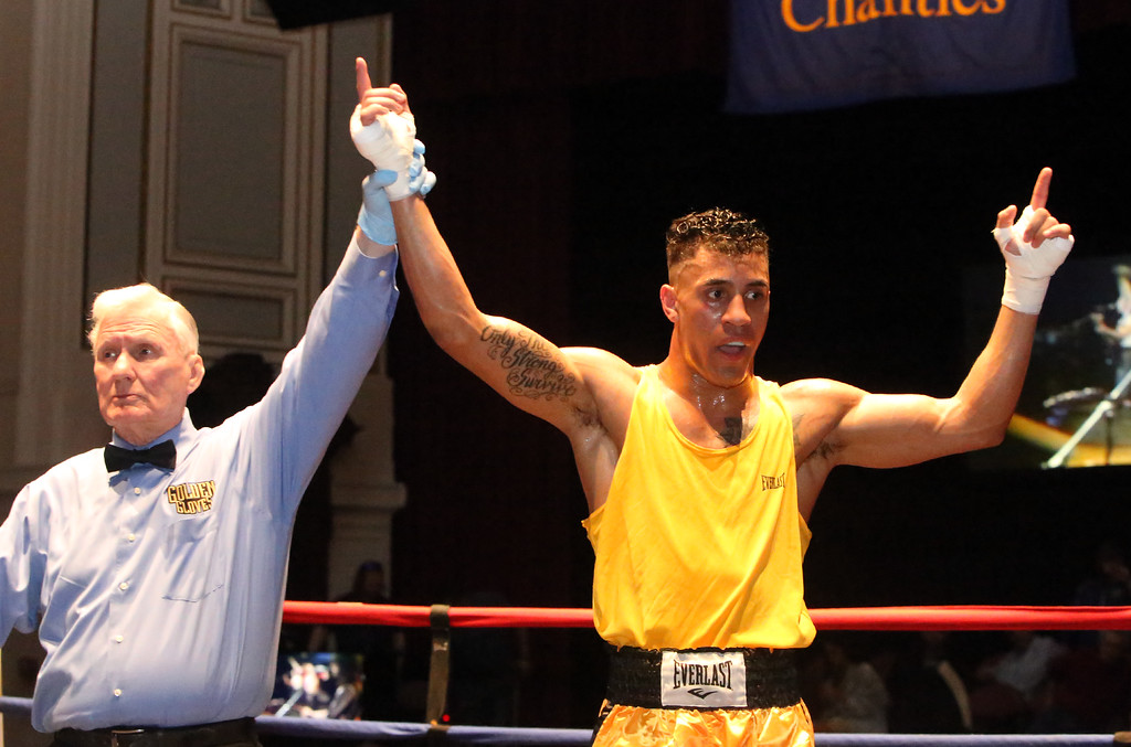 . New England Golden Gloves, Open Division. Josniel Castro of Portland, ME (NNE, Red corner) was winner by unanimous decision over Luca Botis of West Point, NY (WNE, Blue corner) in 152 lb Open semifinal. Referee is Mike Ryan. (SUN/Julia Malakie)