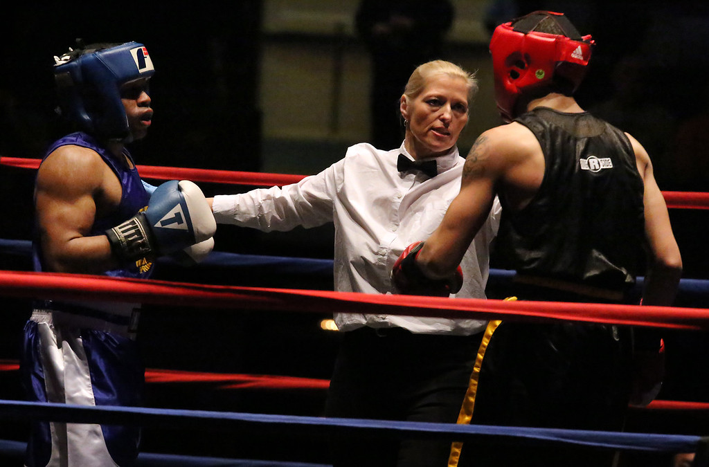 . New England Golden Gloves, Open Division. Jonathan DePina of Dorchester (Red corner), right, was winner by a 3-2 decision over Joshua Orta of Springfield (Blue corner), left, in 132 lb Open semifinal. Referee is Lucy Miller. (SUN/Julia Malakie)
