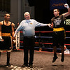 Greater Lowell Golden Gloves boxing, week 2. Steve Rao of Lowell West End Gym (Red corner), right, is declared the winner by a 3-2 decision vs Miguel Rivera of Intenze 978 (Blue corner) in 141 lb Novice bout. (SUN/Julia Malakie)