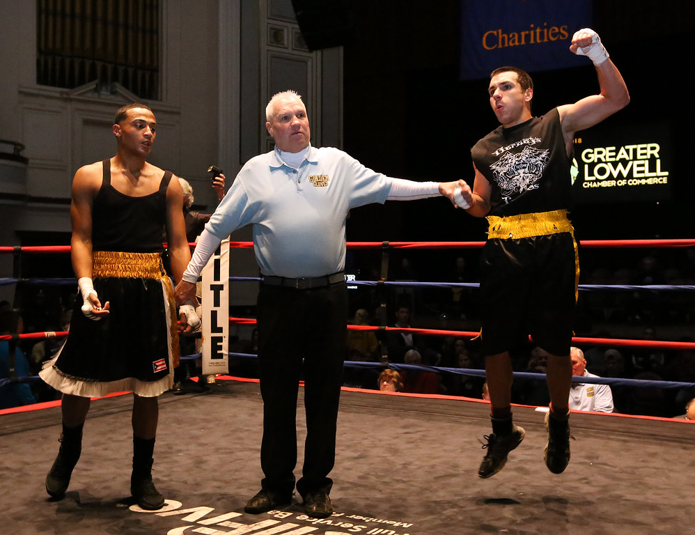 . Greater Lowell Golden Gloves boxing, week 2. Steve Rao of Lowell West End Gym (Red corner), right, is declared the winner by a 3-2 decision vs Miguel Rivera of Intenze 978 (Blue corner) in 141 lb Novice bout. (SUN/Julia Malakie)