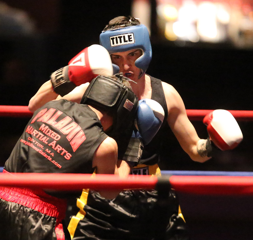 . Greater Lowell Golden Gloves boxing, week 2. Robert Tomczyk of Palladin Martial Arts (Blue corner), front left, won by unanimous decision vs Scott Nardella of Lowell West End Gym (Red corner), right in 141 lb Novice bout. (SUN/Julia Malakie)