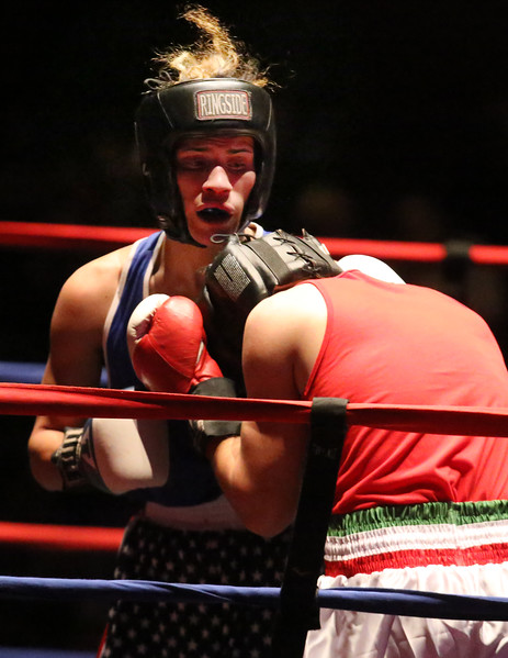 Greater Lowell Golden Gloves boxing, week 2. Kevin Rodriguez of Intenze 978 (Blue corner), rear, won by unanimous decision vs Giovanni Picariello of Nonantum Boxing (Red corner) in 132 lb Novice bout. (SUN/Julia Malakie)