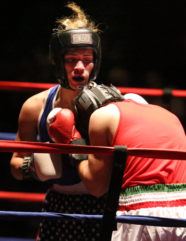 . Greater Lowell Golden Gloves boxing, week 2. Kevin Rodriguez of Intenze 978 (Blue corner), rear, won by unanimous decision vs Giovanni Picariello of Nonantum Boxing (Red corner) in 132 lb Novice bout. (SUN/Julia Malakie)