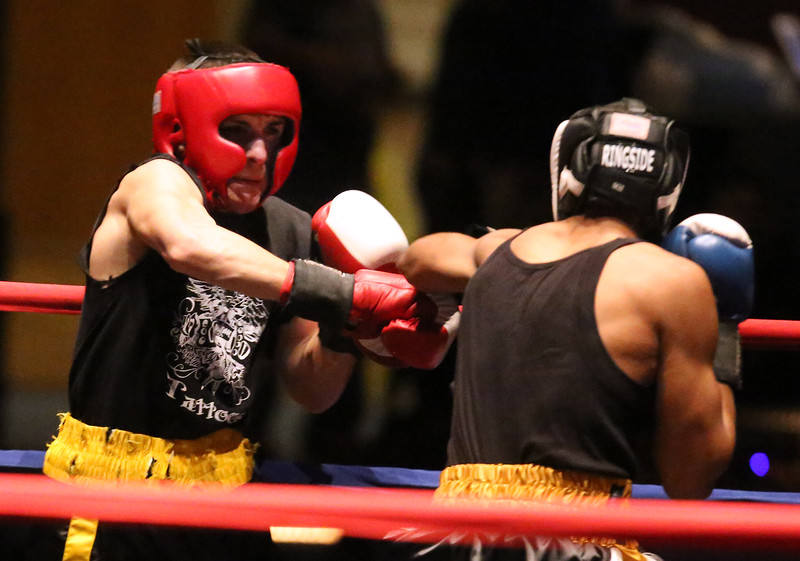 Greater Lowell Golden Gloves boxing, week 2. Steve Rao of Lowell West End Gym (Red corner), left, won by a 3-2 decision vs Miguel Rivera of Intenze 978 (Blue corner) in 141 lb Novice bout. (SUN/Julia Malakie)