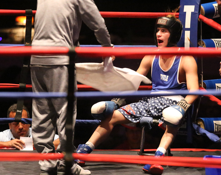 Greater Lowell Golden Gloves boxing, week 2. Kevin Rodriguez of Intenze 978 (Blue corner)gets fanned between rounds. He won by unanimous decision vs Giovanni Picariello of Nonantum Boxing in 132 lb Novice bout. (SUN/Julia Malakie)