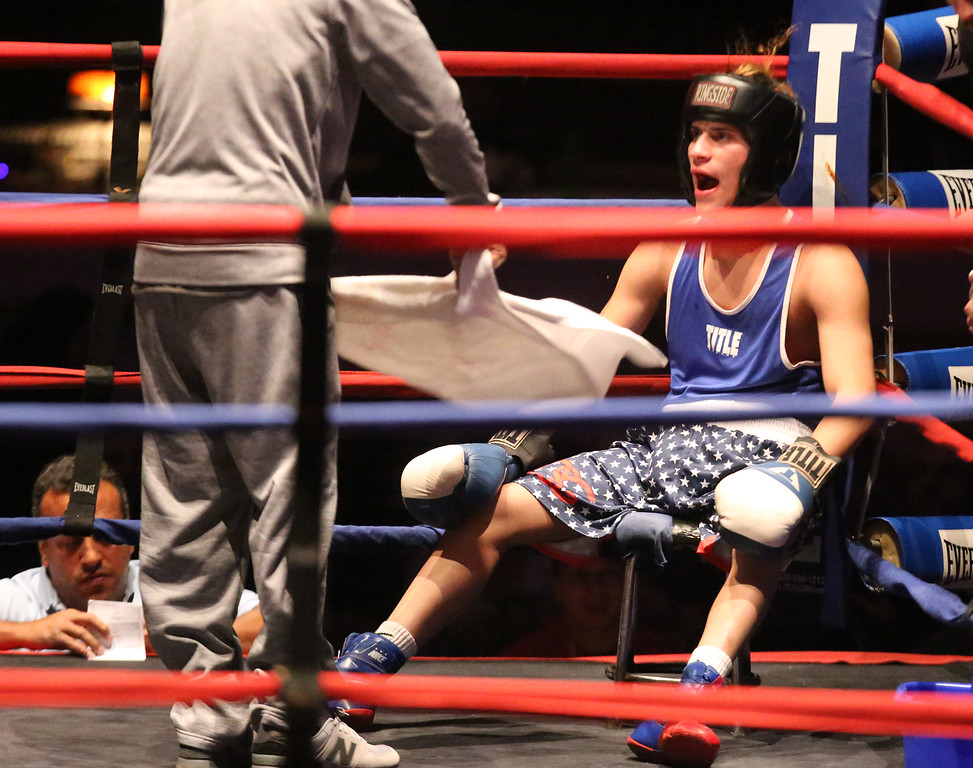 . Greater Lowell Golden Gloves boxing, week 2. Kevin Rodriguez of Intenze 978 (Blue corner)gets fanned between rounds. He won by unanimous decision vs Giovanni Picariello of Nonantum Boxing in 132 lb Novice bout. (SUN/Julia Malakie)
