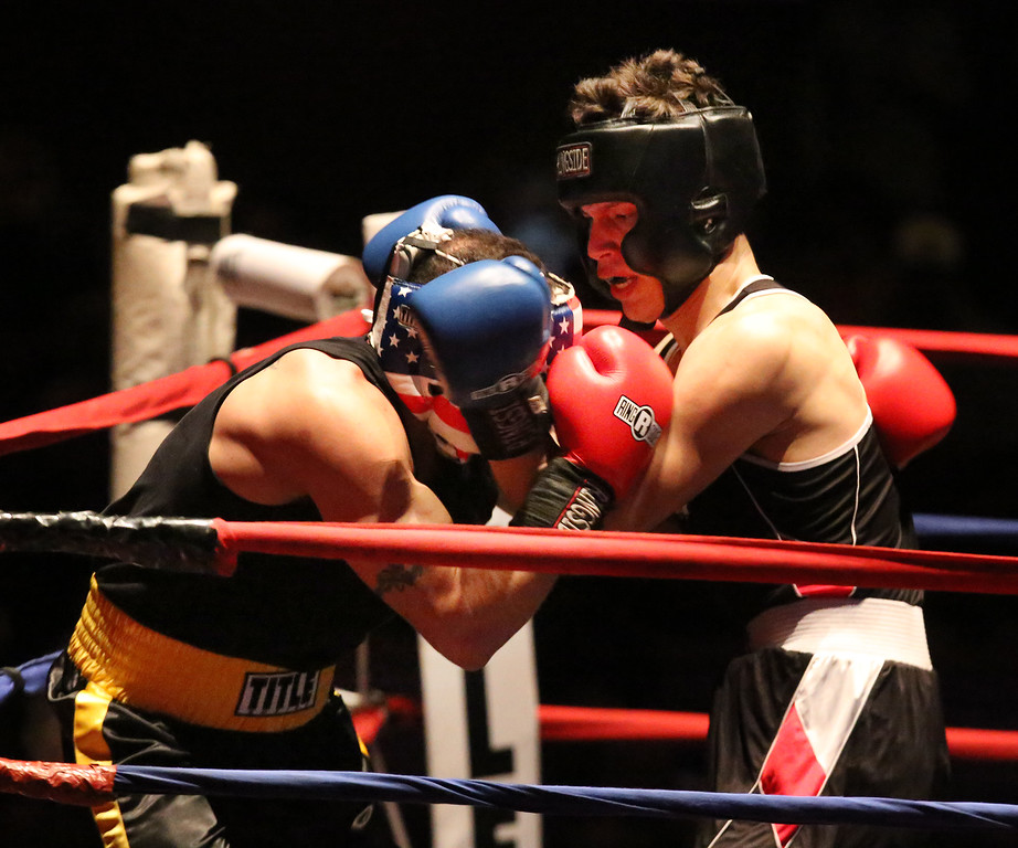 . Greater Lowell Golden Gloves boxing, week 2. Jordy Artica of Grealish Boxing (Blue corner), right, won by decision vs Steve Baez of Lowell West End Gym (Red corner) in 165 lb Novice bout. (SUN/Julia Malakie)