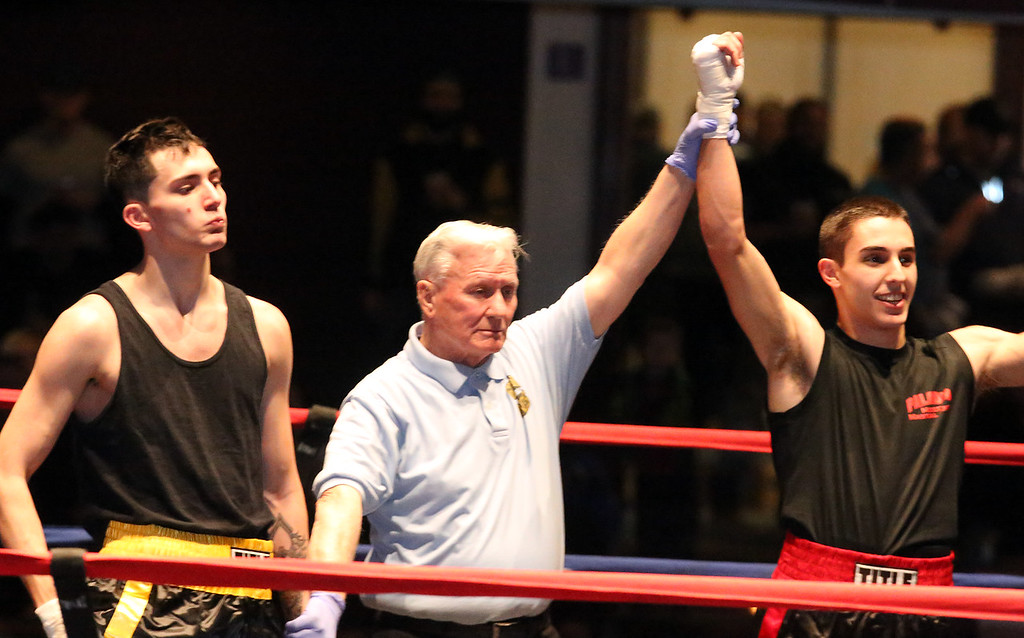 . Greater Lowell Golden Gloves boxing, week 2. Robert Tomczyk of Palladin Martial Arts (Blue corner) won by unanimous decision vs Scott Nardella of Lowell West End Gym (Red corner) in 141 lb Novice bout. (SUN/Julia Malakie)